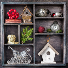 Christmas toys and decorations. Collage in vintage box