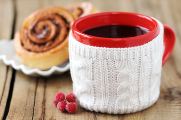 Christmas coffee with cinnamon rolls on wooden background