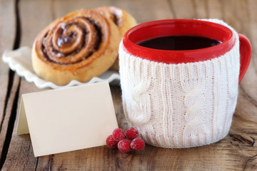 Christmas coffee, cinnamon rolls and greeting card