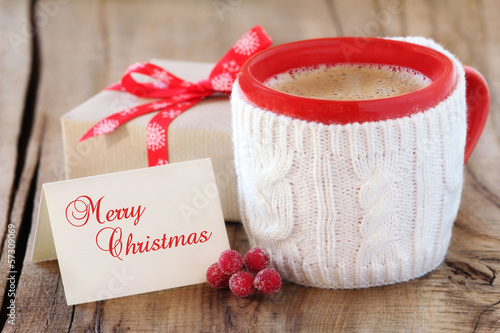 Mug of cofee with Christmas gift and greeting card