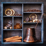 Spices, coffee and chocolate in a vintage wooden box