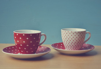 Two polka dots cup of coffee retro