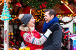 Couple during  Christmas market or advent season
