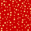 seamless pattern of gold stars on a red background.holiday backg