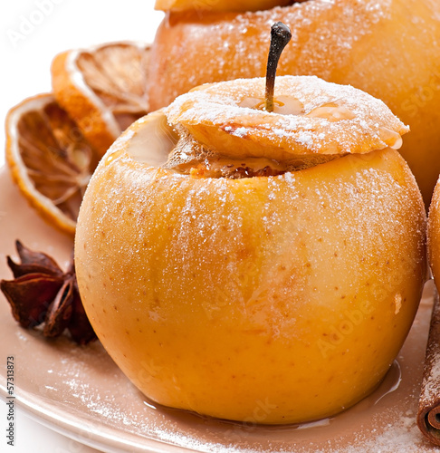 Baked apples with honey and nuts isolated on white background