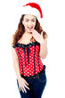 Attractive lady posing with santa cap on