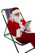 Relaxed male santa operating tablet device
