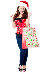Excited shopaholic woman in trendy attire