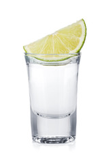 Shot of vodka and lime slice