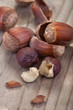 .hazelnuts with its shell on a wooden table
