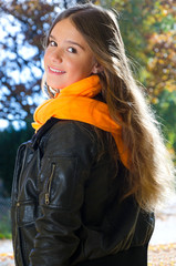 Autumn portrait of cheerful teenager
