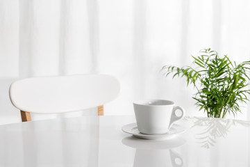 White cup on the kitchen table