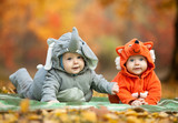 Two baby boys dressed in animal costumes in autumn park - Fine Art prints