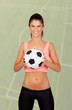 Brunette woman with a soccer ball
