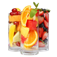 Fruit cocktails isolated. Fresh pieces of fruits in glasses