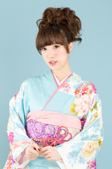Beautiful asian kimono woman on blue background