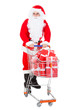 Portrait of santa holding shopping cart