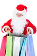Surprised santa looking inside shopping bag