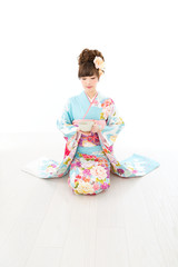 Beautiful asian kimono woman on white background