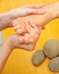 female foot on massage spa treatment
