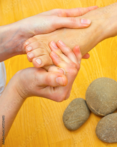 female foot on massage spa treatment