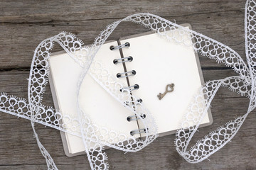 romantic notebook and white  lace