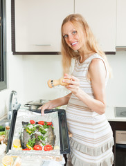pregnancy woman cooking trout fish