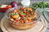 Casserole of chicken in an ovenproof dish with vegetables
