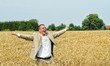 young person shouting in the wheat field