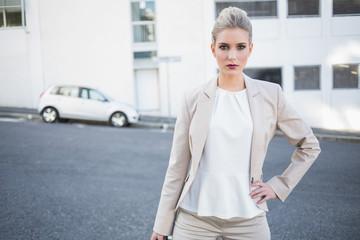 Serious stylish businesswoman posing
