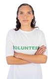 Brunette wearing volunteer tshirt with arms crossed