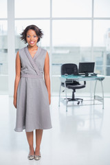 Smiling businesswoman standing in her office