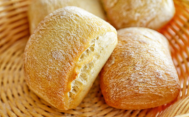 Small breads in village basket closeup image