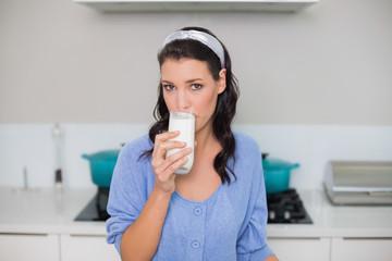 Content gorgeous model drinking milk