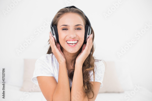 Happy attractive brunette listening to music