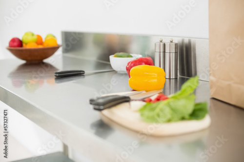 Vegetables and chopping board on a chrome counter