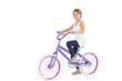Smiling cute young girl riding bike
