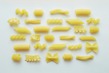 Different types of pasta on white background