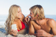 Woman putting sun cream on nose of her partner