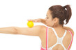 Rear view of sporty brunette touching arm with yellow massage ba