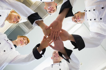 Chefs joining hands in a circle