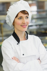 Smiling female chef posing in a kitchen