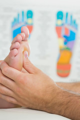 Close up picture of physiotherapist massaging a patients foot