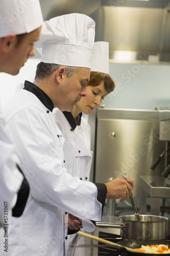 Head chef inspecting his students pot