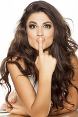 nice and beautiful girl sends a kiss from her finger