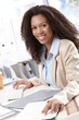 Happy businesswoman working at desk