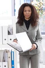Pretty businesswoman with folder