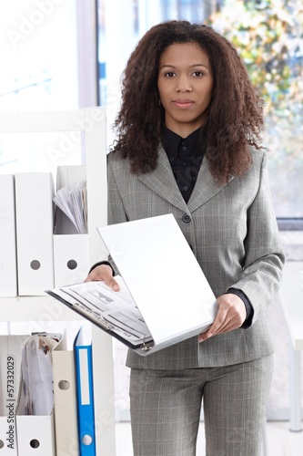Pretty businesswoman with folder