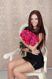 Portrait of young beautiful happy smiling girl with pink roses f