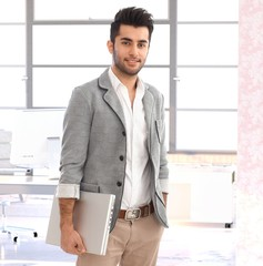 Modern young arabian businessman at office